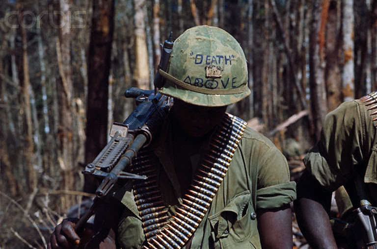 Activities atop Hill 875, Dak To, South Vietnam, 1967, by Kyoichi Sawada