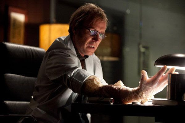 Dr. Curt Connors (Rhys Ifans) begins to transform into The Lizard in THE AMAZING SPIDER-MAN.