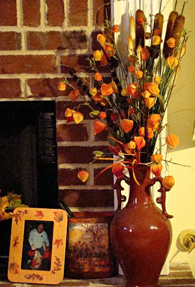 vase of Chinese lanterns and cattails