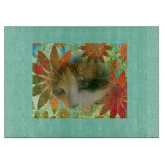 snowshoe sixties flower child kitty cutting board