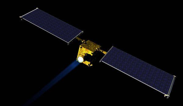 An artist's concept of NASA's DART spacecraft firing its ion engine during flight.