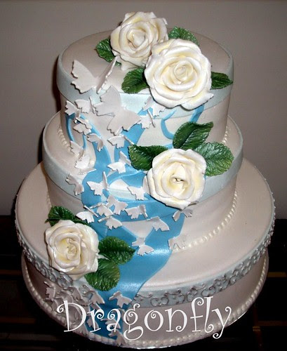 Aqua Wedding Cake with butterflies and sugar flowers royal blue wedding