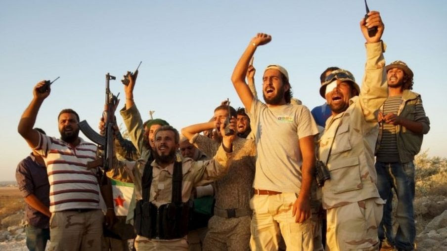 Free Syrian Army fighters celebrate taking control of the city of Tal al-Zaatar (13 August 2015)