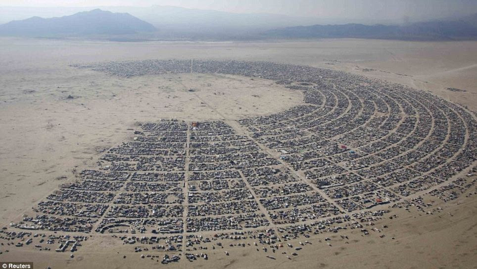 New wave: From its humble beginnings, the Burning Man festival now expects 68,000 participants this year - and the encampment will resemble this by the end of the week
