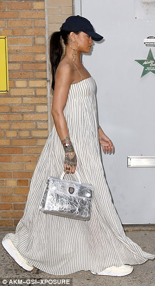 Shining through: Rihanna sported a stunning silver handbag while at work that day