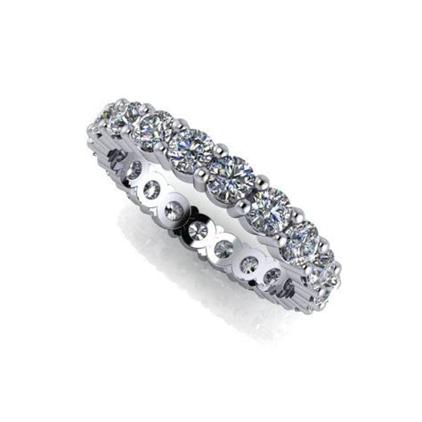 An eternity band featuring Charles & Colvard Forever