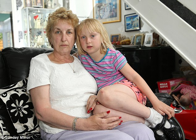 Debt: Mrs Tollefsen with Freya, seven, also owes £32,000 to friends who lent her cash tobankroll the bogus deal