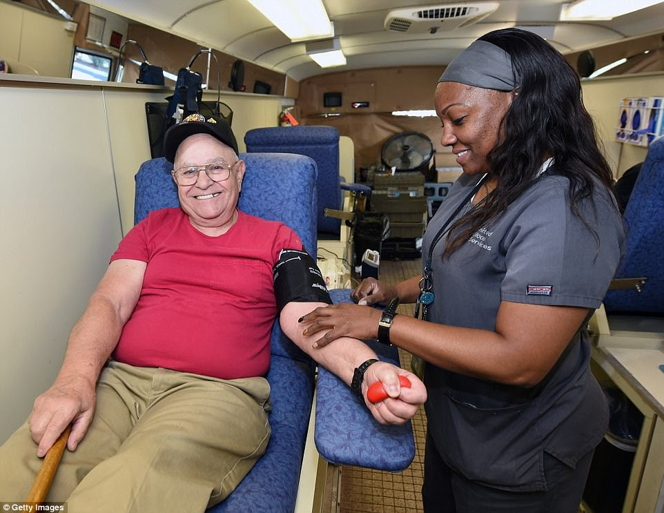 Richard Williams of Nevada smiles as United Blood Services phlebotomist Sha-Na Hill  takes his blood at a special United Blood Services drive at a University Medical Center facility to help victims of the Las Vegas mass shooting
