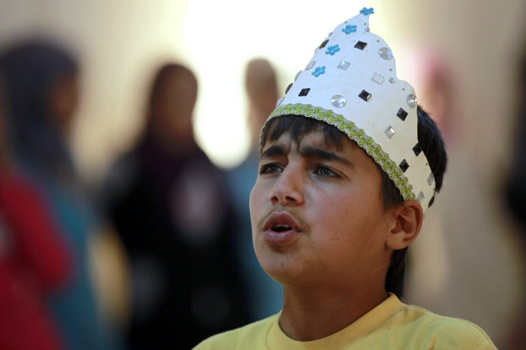 Syrian refugee Majd Ammari, 13, performs the role of King Lear during a rehearsal at the sprawling Zaatari refugee camp in the Jordanian desert near the border with Syria, March 8, 2014. (photo credit: AFP/Khalil Mazraawi)