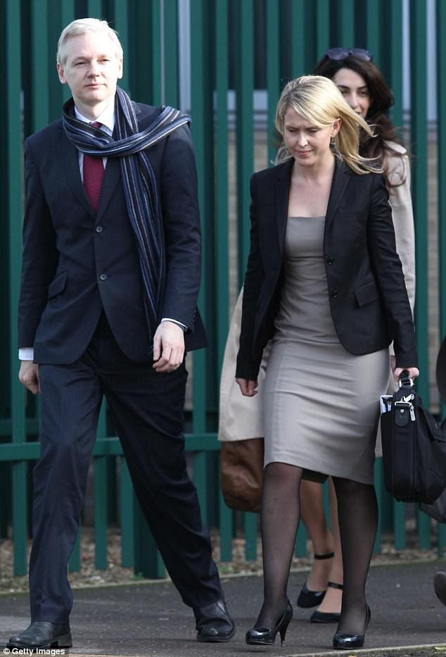 Ms Robinson (right) has worked on Wikileaks founder Julian Assange's legal team since October 2010 and is best friends with Amal Clooney - pictured right in the background