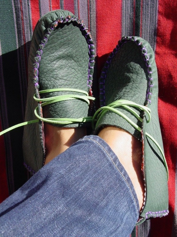 green leather moccasins
