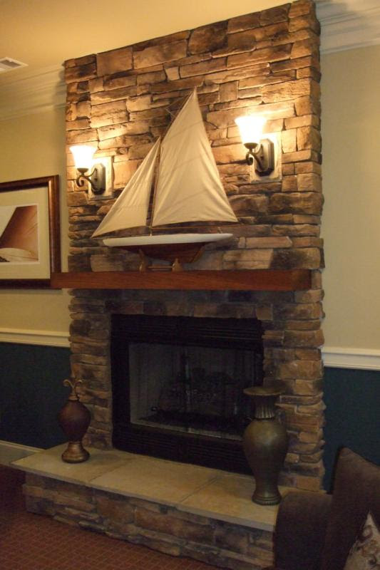 Modern House Interior Sconces Lighting Over Fireplace