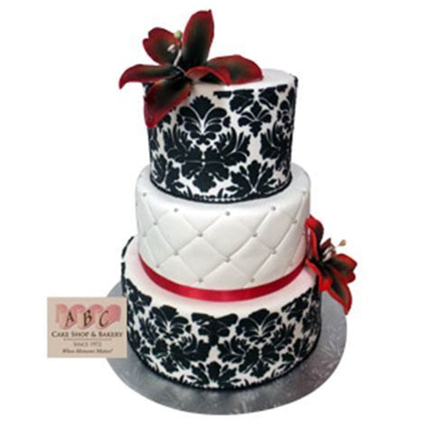 (2383) 3 Tier Wedding Cake with black stenciling and red