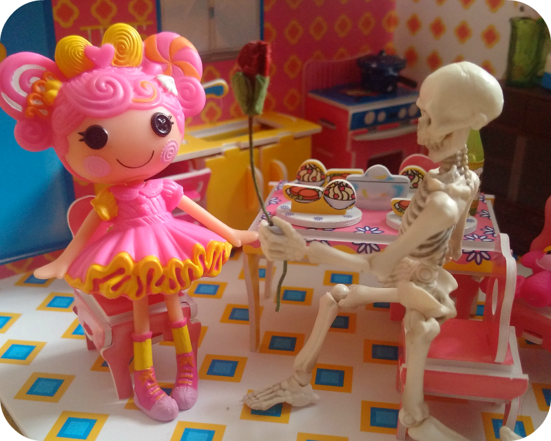 Pose skeleton presents mini lalaloopsy with a rose