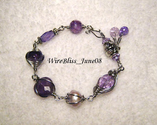 Wire wrapped purple themed Bracelets