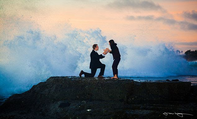 Breaker: Matthew Hartman was down on one knee, just at the point of proposing to his girlfriend Lis, when a giant wave rushed in from the ocean and swept the couple completely off their feet