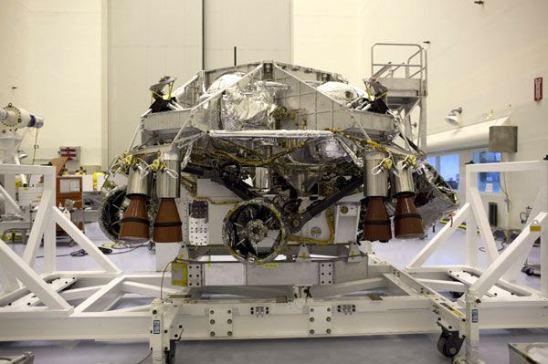 The Curiosity Mars rover and its descent stage prior to being enclosed by the backshell at NASA's Kennedy Space Center in Florida.