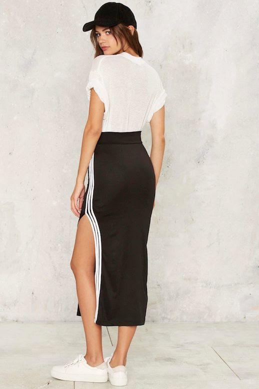Le Fashion Blog Sporty Style Black Hat Oversize Tucked In White Tee Shirt Side Slit Stripe Midi Skirt Sneakers Via Nasty Gal