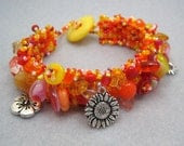 Beaded Cuff Bracelet - Orange Yellow Red Pink Summer Vivid Bright by randomcreative on Etsy - randomcreative