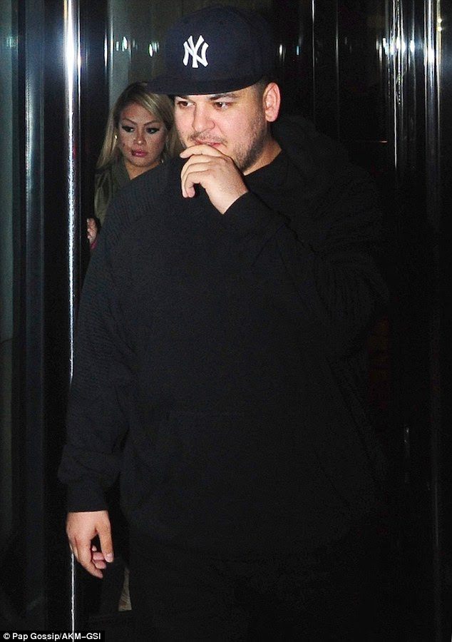 Kasual Kardashian: Sporting his usual laid-back look, Rob wore a black baggy hoodie and matching jeans, along with white sneakers and - fittingly - a New York baseball cap