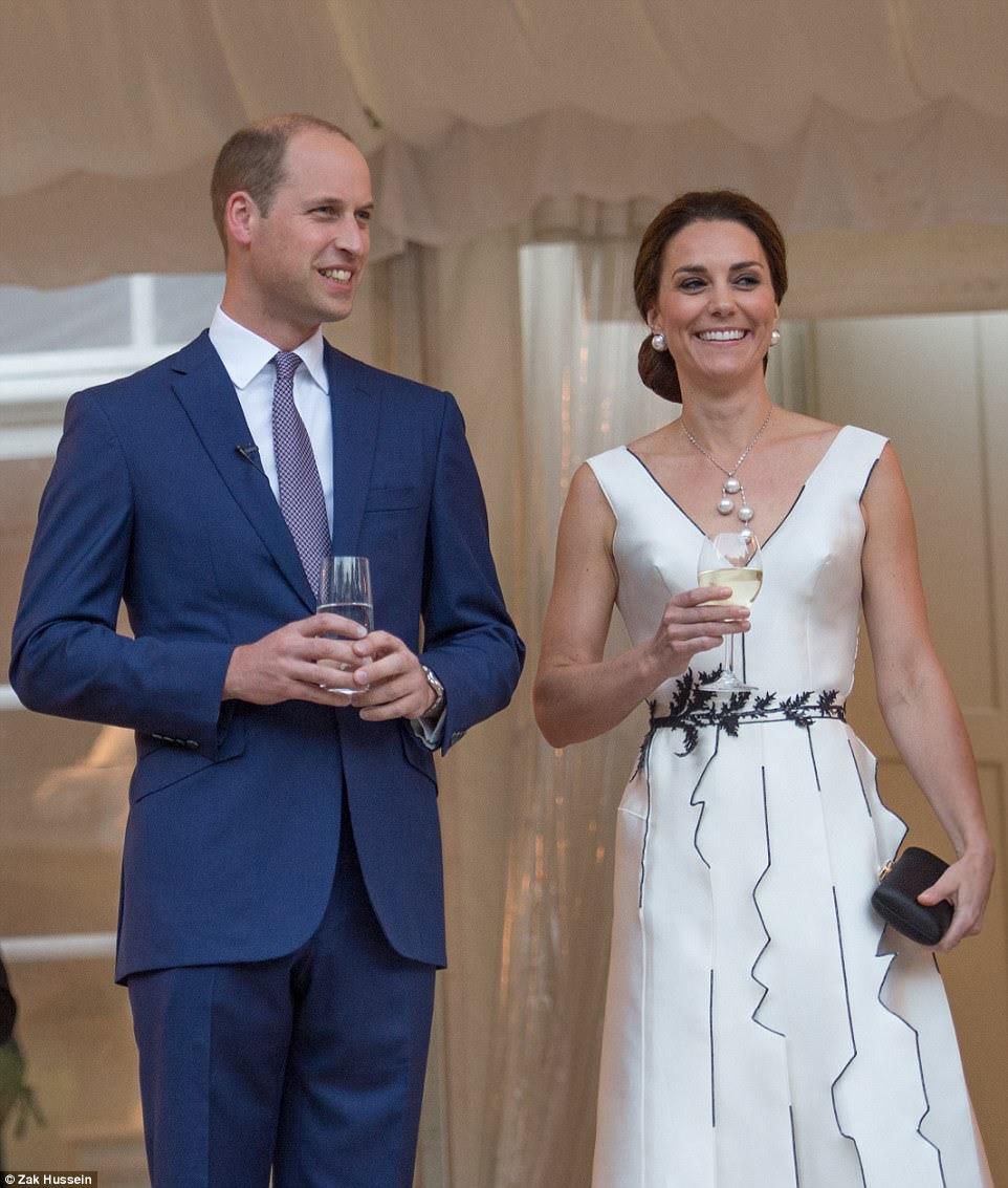 William enjoys a well-earned drink after his speech in which he hailed the country's 'courage, fortitude and bravery' in surviving centuries of assaults, and especially its 'incredible bravery' during the brutal Nazi occupation