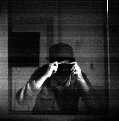 reflected self-portrait with Purma Special camera and baseball cap by pho-Tony