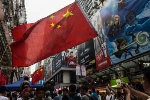 Pro-Beijing activists wave China's national flag…
