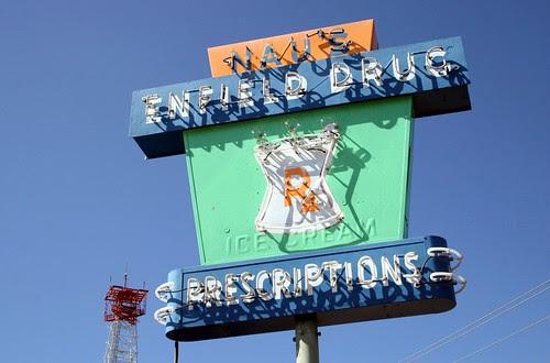 nau's enfield drug neon sign