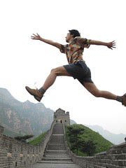 跨越长城 Across the Great Wall we can reach every corner in the world.