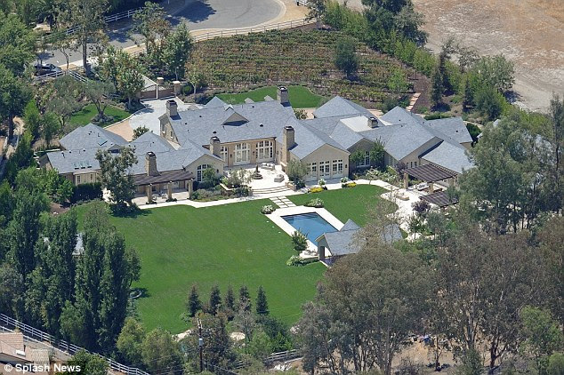Kim Kardashian and Kanye West snap up $3m fixerupper home next door to their new mansion