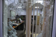 "In this picture taken on Tuesday, Nov. 29, 2011, and released by Iranian Fars News Agency, a shattered window of an office of the British Embassy is seen, after hard-line students stormed in, Tehran, Iran. Britain set in motion the withdrawal of some diplomatic staff and families from Tehran on Wednesday as Iran's parliament speaker blamed Britain's ""domination-seeking"" policies for the storming of British compounds by hard-line Iranian protesters the day before. In Tuesday's assault on the British Embassy and a residential complex, mobs hauled down British flags and ransacked offices in retaliation for Britain's support of tighter sanctions against Iran over its nuclear program. (AP Photo/Fars News Agency, Mehdi Marizad)"