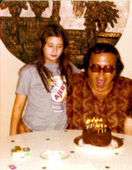 Dawn Lerman at age 10 with her father at a birthday celebration.