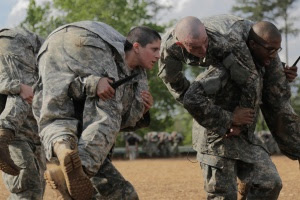 Then-U.S. Army First Lieutenant Kirsten Griest (C) and fellow soldiers participate in combatives training during the Ranger Course on Fort Benning, Georgia, April 20, 2015. REUTERS/Spc. Nikayla Shodeen/U.S. Army/Handout via Reuters