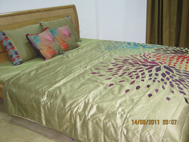 "Bed in the master bedroom in a 3 BHK ""Show"" Flat in Om Developers' Tropica, Blessed Township at Ravet PCMC, Pune 412 101"