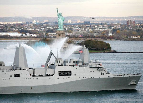 The USS NEW YORK passes by the Statue of Liberty after arriving at its namesake state on November 2, 2009.