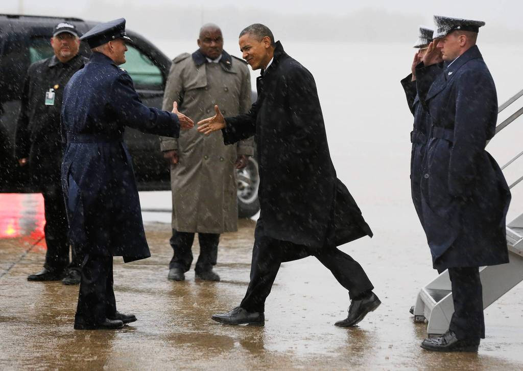 U.S. President Barack Obama arrives at Joint Base Andrews outside Washington after cancelling a campaign event in Florida due to bad weather in the Washington area. Obama canceled campaign events in Florida and Wisconsin to return to Washington on Monday and monitor the impact and response to Hurricane Sandy, the White House said.