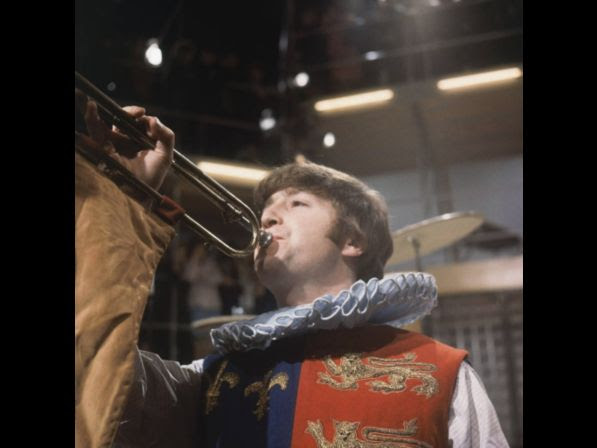 The Beatles rehearse for their forthcoming television show at Wembley studios in London, April 1964. In this skit, John Lennon plays a Herald sounding a horn.