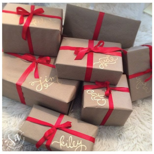 names in gold sharpie... this kind of pretty simplicity is right up my alley. Perfect for rustic packaging for christmas