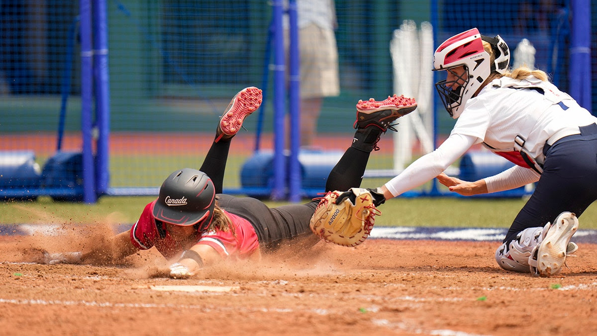 Team USA's thrilling play at the plate saves run, gives them second Olympic softball victory