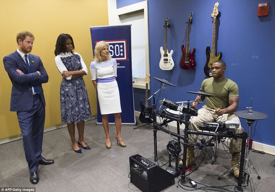 Performance: Marine Sgt Liggens performed on the drums for the Prince, the First Lady and the vice-president's wife at the USO Center