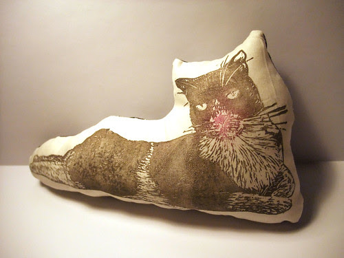 pink-nosed cat pillow