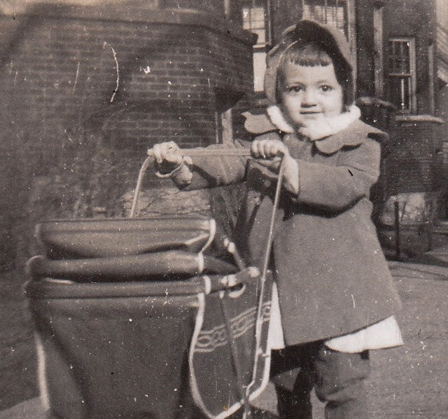 Pushing Dolly in a Stroller- 1940s Vintage Photograph