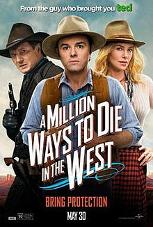 Three people dressed in Western style. On the left in the background a man dressed in dark colors with a gun held high. In the centre a man in a blue shirt with a brown waistcoat, and to his right a blonde woman