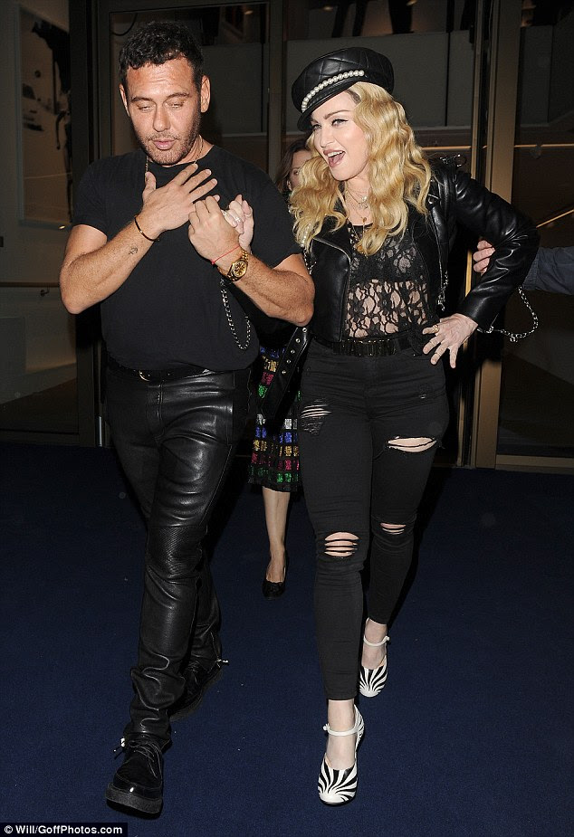 She's a Material Girl: Pop legend Madonna opted for an edgy leather jacket, sheer top and ripped black jeans for hr appearance at the party