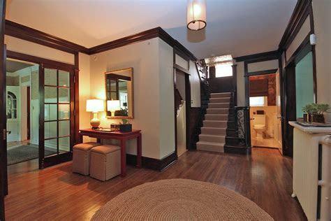 Light walls dark trim dining room traditional with pendant light wood floor dining table