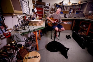 Guitar maker and repairer Glyn Evans says a good luthier should respect an instrument's story. Photo / Dean Purcell