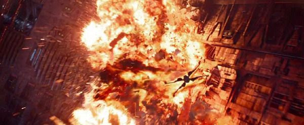 A Resistance X-Wing fighter flies away from an explosion in STAR WARS: THE FORCE AWAKENS.