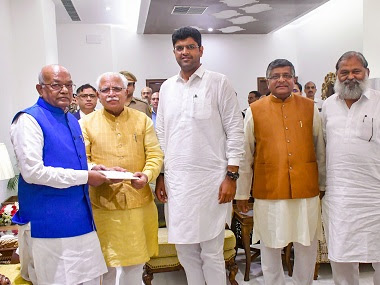 Haryana Chief Minister-designate Manohar Lal Khattar with JJP chief Dushyant Chautala meets Governor Satyadeo Narain Arya to stake claim for forming the next government in the state. PTI