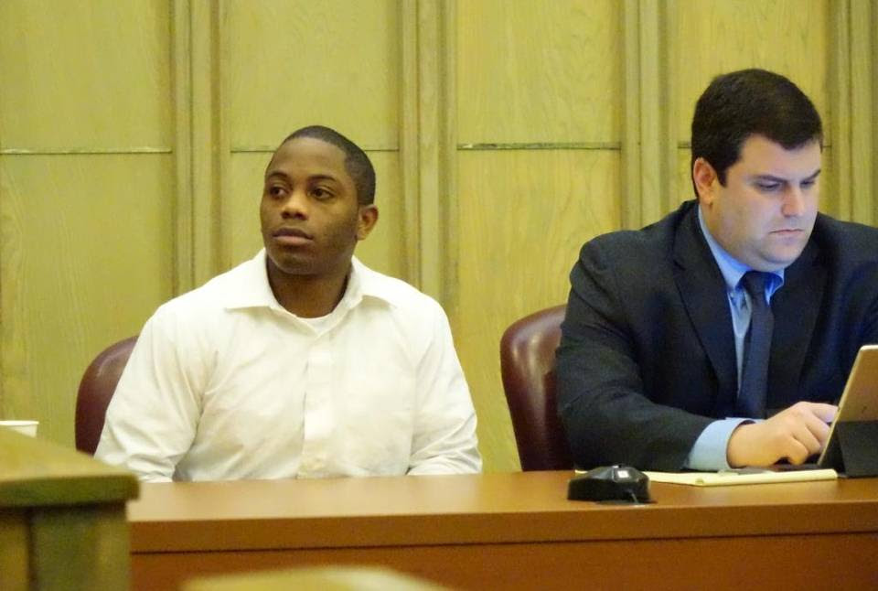 Nathaniel Payne-Collins, 22, left, was acquitted at trial on allegations he murdered security guard Robert Nelson in South Miami-Dade in August 2013. At right is his defense attorney, Ayuban Tomas.