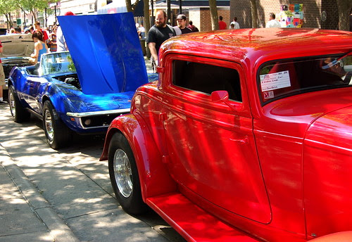 A red Ford and a blue Chevy